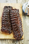 Two Full Racks of Baby Back Pork Ribs on Cutting Board
