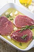 Steaks Marinating in Rosemary Garlic Oil