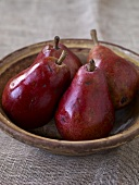 Four Red Pears in Wooden Bowl