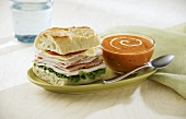 Turkey Sandwich with a Bowl of Tomato Soup