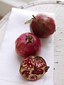 Half a Pomegranate; Two Whole Pomegranates