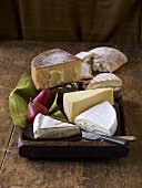 Various Wedges of Cheese with Pears; Bread