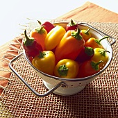 Red, Yellow and Orange Peppers in Colander