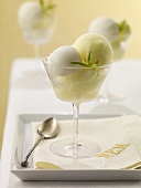 White and Yellow Sorbet in Stem Glass; On Tray with Napkin and Spoon