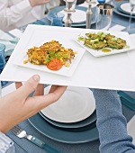 Person Holding Platter of Latkas; Zucchini Latka with Jalapeno and Apple Jelly; Corn and Squash Latke