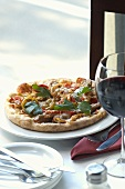 Individual Pizza with Italian Sausage; Wine