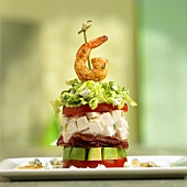Stacked Cobb Salad Topped with Shrimp