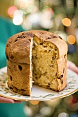 Woman Holding Panettone with Slice Removed