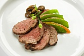 Sliced Beef with Pea Pods on White Plate