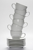 White Coffee Cups Stacked on Stacked Saucers