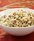 Bowl of Herbed Rice Pilaf with Sliced Almonds