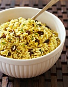 Bowl of Curried Rice Salad with Raisins