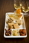 Appetizer Platter with Cheese, Crackers and Nuts; White Wine