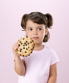 Little Girl Holding Large Chocolate Chip Cookie