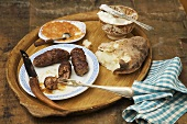 Cevapcici Sausage on Rustic Platter with Bread