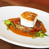Seared Halibut atop Mixed Vegetable Patty with Tomato Sauce