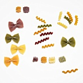 Various Types of Dried Pasta on White Background