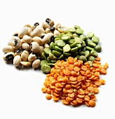 Three Piles of Assorted Lentils and Beans; White Background