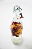 Bottle of Homemade Cranberry and Orange Vodka