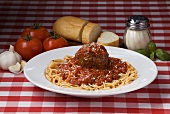Spaghetti with One Large Meatball and Sauce; Ingredients and Bread