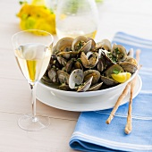 Bowl of Steamed Clams with Grissini and White Wine