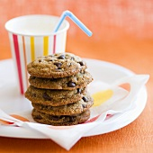 Stack of Chocolate Chip Cookies with a Cup of Milk with a Straw