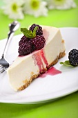 Piece of Cheesecake with Blackberry Topping and Mint
