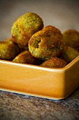Fried Sicilian Green Olives in an Orange Dish