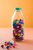 Retro Gumballs in and Beside a Bottle