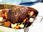 A Whole Chuck Roast in a Roasting Pan with Veggies