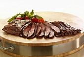 Sliced Flank Steak on a Wooden Board