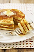 Stack of Pancakes with Butter and Syrup; Sliced with Fork