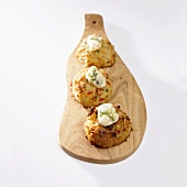 Crabcakes with Tartar Sauce and Dill on Cutting Board