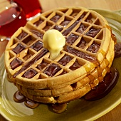 Stack of Three Waffles with Butter and Maple Syrup