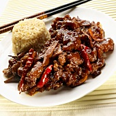 Orange Beef with Fried Rice and Chopsticks