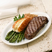 Surf and Turf: Grilled NY Strip Steak with Lobster Tail and Asparagus