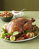 Thanksgiving Turkey on Platter with Fruit; Stuffing and Gravy