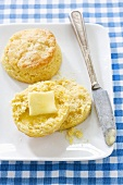 Cornmeal Biscuit Halved with Butter; On Plate with Biscuit