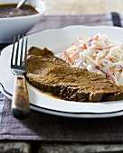 Slice of Brisket with Coleslaw on a Plate