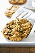 Spatula Lifting Oatmeal Raisin Cookie from Pan