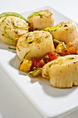 Lime Grilled Scallops with Lime Zest on a White Plate