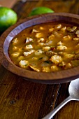 Bowl of Posole; Mexican Hominy and Pork Stew; On Wooden Table