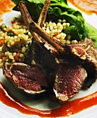 Seared Lamb Chop Lollipops on Moroccan Couscous with Red Chili Coulee