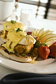 Eggs Benedict with Crab Cakes on Restaurant Table
