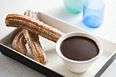 Fried Churros with a Bowl of Chocolate Sauce