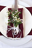 Place Setting with Maroon Napkin and Spring Flowers