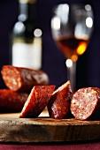 Hungarian Chorizo on a Cutting Board; Glass of Sherry