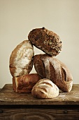 Artisan Bread Loaves Stacked on Wooden Table