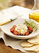 Goat Cheese Round with Halved Tomatoes, Olives and Oil
