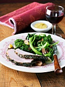 Rosemary Crusted Pork Tenderloin Slices with Broccoli Rabe